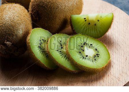 Fresh Ripe Sliced Kiwi Fruit, Whole Half And Piece Organic Juicy Kiwi Fruits On Wooden Background