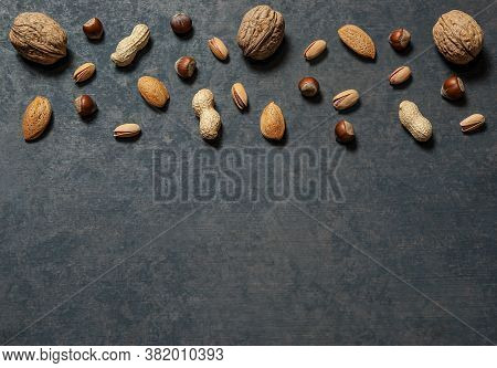 Nuts Mix Dried Fruits In Bowl, Different Kind Of Nut, Healthy Food On Wooden Table. Walnut, Hazelnut