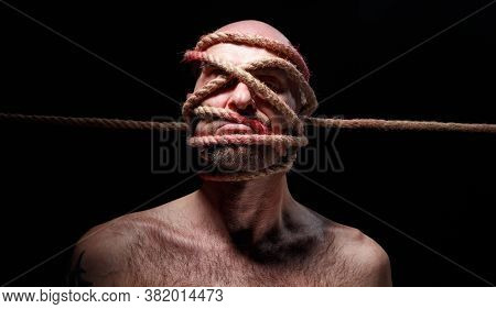Image Of Binded Bald Adult Man With Rope On Face
