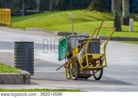 Yellow Street Cleaner Cart On An Empty Street