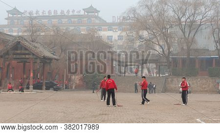 Shaolin, Luoyang, Henan Province / China - January 4, 2016: Young Apprentices Train In The Yard Of S