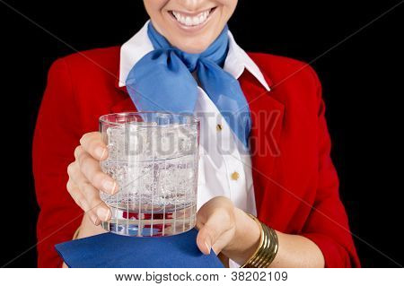 Flight Attendant Serving A Drink