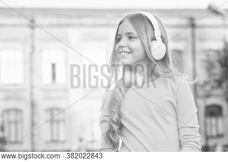 Music For Soul. Modern Child. Music Channel. Girl Listening Music Modern Gadget. Kid Happy With Wire