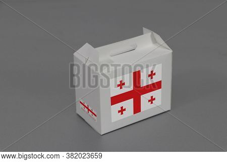 Georgia Flag On White Box With Barcode And The Color Of Nation Flag On Grey Background. The Concept