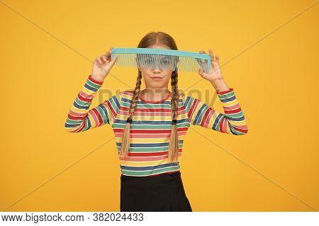 Beautiful Hair With Beautiful Care. Little Girl Hold Plastic Comb Yellow Background. We Care About Y