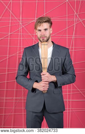 Threatening Violence. Businessman Formal Elegant Suit Pink Background. Man Hold Wooden Bat. Man With