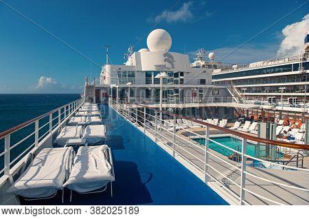 Miami, Usa - December 31, 2015: Eurodam Cruise Ship. Pool And Sun Deck Area Outdoors. Sun Loungers.