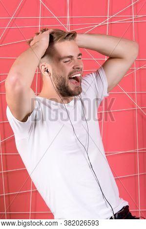 Man Unshaven Bearded Listen Music Earphones. Listen Music Radio With Portable Gadget. Song Inspiring
