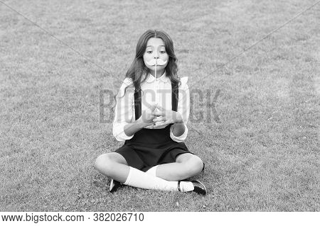 Ready For School Party. Little Child Hold Mustache Props Green Grass. Small Girl With Photobooth Pro