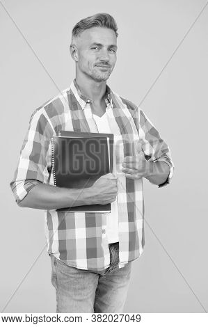 Handsome School Or University Teacher. Thumb Up. Adult Man Student Holding Notebooks. Man With Folde