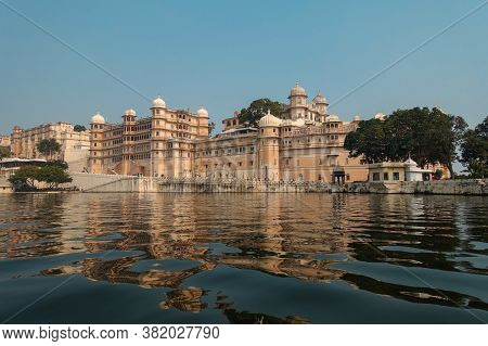 View Of The City Palace From A Boat Cruise On Lake Pichola. One Of The Most Important Landmarks Of U