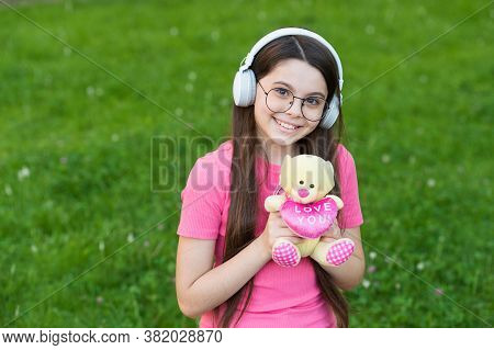 Girl Listening Summer Melody Wireless Headphones Nature Background, Living Happy Life Concept.