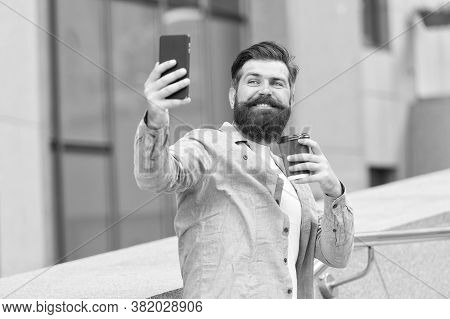 Chatting And Meeting With Friends Online. Bearded Man Chat Online Via Cellphone. Online Meeting. Aud