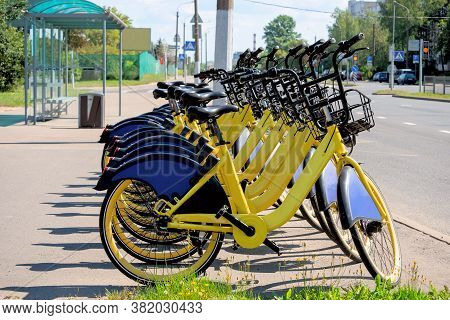 A Lot Of Yellow Bikes Rental Are Standing On At A Public Transport Stop.  Ecological Transport.