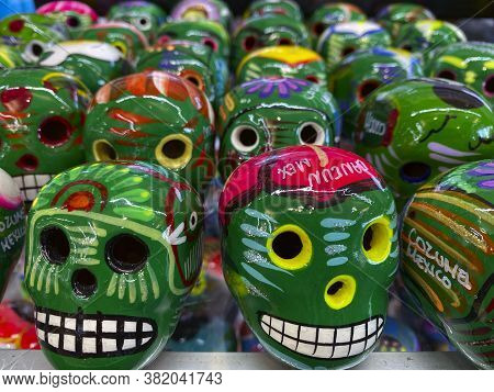 Day Of The Dead In Mexico. Beautiful Bright Masks In The Handmade Market.festive Traditions In Mexic
