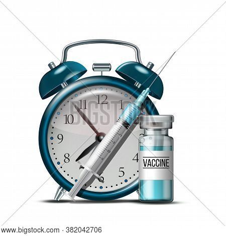 Time To Vaccinate Concept. Syringe, Bottles Of Vaccine And Alarm Clock.