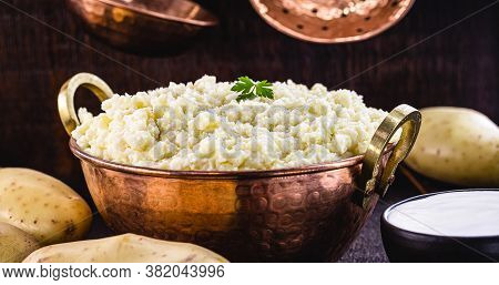 Mashed Potatoes In Copper Metallic Pan, Brazilian Food Served As A Garnish Or Side Dish.