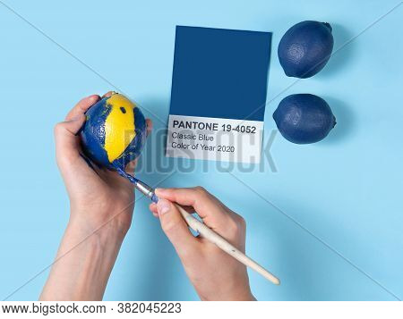 Lemon Is Repainted In The Color Of The Year, Blue Is The Classic Color. Concept: Following Fashion,