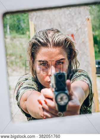 Close-up Abstract View Of Attractive Female Army Soldier Have Gun Shooting Training From Behind And