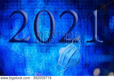 Text With The Year Number 2021 With A Background Of Out-of-focus Bright Blue Lights With Bokeh Effec