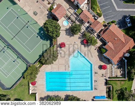 Aerial View Swimming Pool And Tennis Court In Middle Class Neighborhood Community In Rancho Bernardo