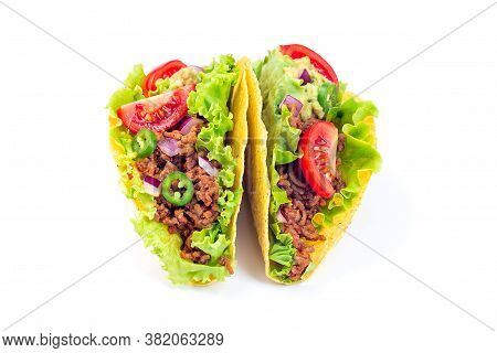 Two Taco Shells Isolated On A White, With Lettuce, Ground Beef Meat,  Mashed Avocado, Tomato, Red On