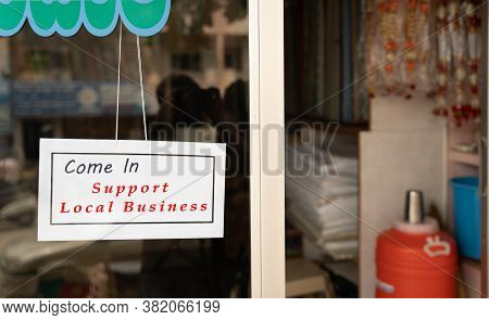 Come In Support Local Business Signage Attached Infront Of Door During Coronavirus Or Covid-19 Pande