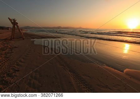 Beautiful Sunrise On The Beach With Pink And Orange Colors In Arenales Del Sol, Alicante,southern Sp