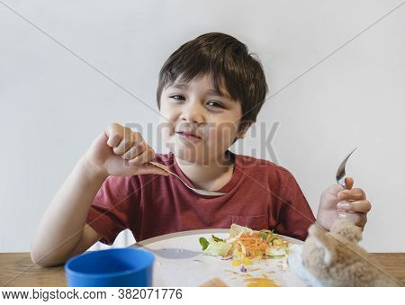 Healthy Kid Eating Mixed Vegetables Salad For His Meal, Happy Child Looking At Camera With Smiling F