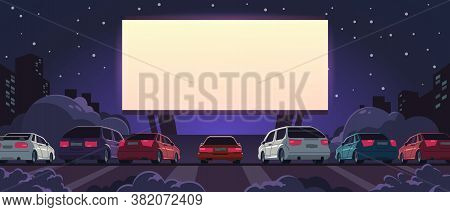 Drive-in Cinema. Open Space Auto Theater With Cartoon Glowing White Screen And Car Parking, Outdoor