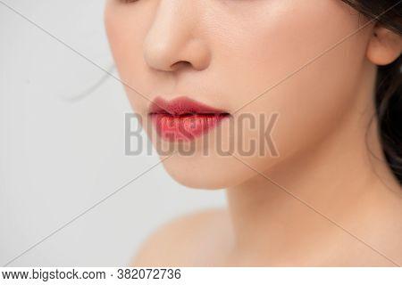Close-up Shot Of Woman Lips With Red Lipstick. Beautiful Perfect Lips. Sexy Mouth Close Up. Beautifu