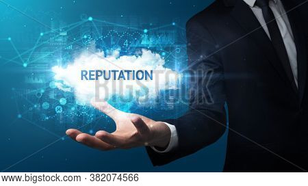 Hand of Businessman holding REPUTATION inscription, successful business concept