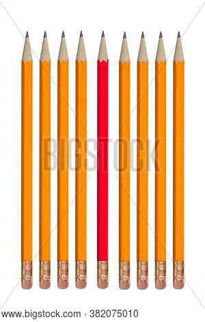 Red Pencil Among Orange Pencils In A Row, Concept Of Individuality Or Odd One Out. Isolated On White