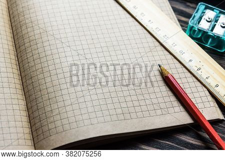 Graph Paper Of Notebook Background, Blank Page Of Retro Sketchbook And Pencil. Top View Of Vintage G