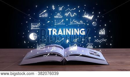 TRAINING inscription coming out from an open book, business concept