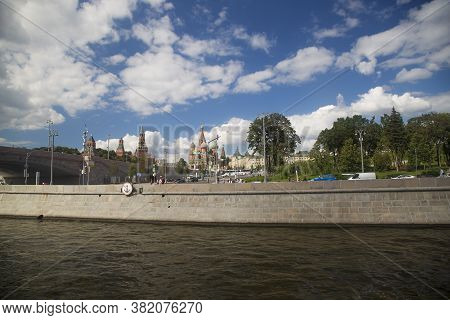 Moscow, Russia - August 21, 2020: Spasskaya Tower And Cathedral Of Vasily The Blessed Saint Basils C