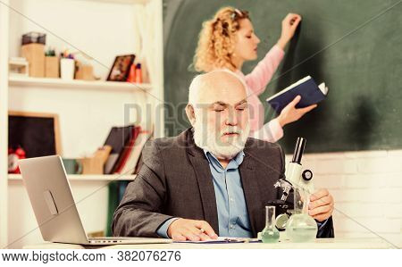 Student Study. Educator And Student Classroom. Girl With Notepad Near Chalkboard. College University