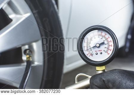 Tire Pressure Gauge In A Hand With Air Pressure Testing