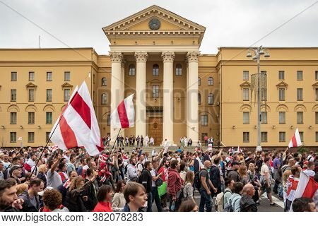 Minsk, Belarus - Aug 23, 2020: March of New Belarus in Minsk. Thousands of people gathered again to demand new fair elections and resignation of Lukashenko. KGB building at background