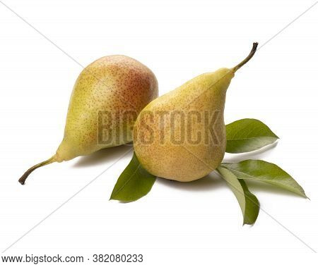 Two Ripe Pears With Green Leaf On White Background