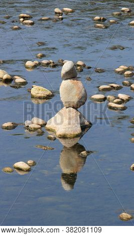 River Stones Pile Along Sesia River Piedmont, Italy