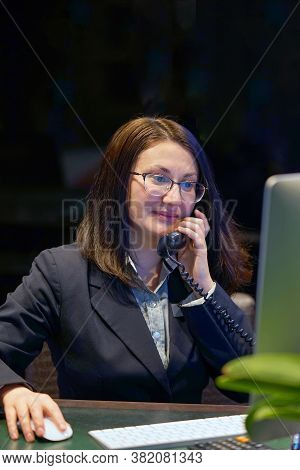 Woman Answers Customer Calls In A Call Center. Secretary Answers The Phone And Talks With Clients, S