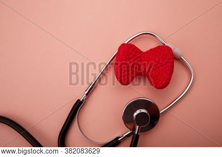 Concept Of Diagnosis And Detecting Diseases Of Endocrine System Organ - Thyroid Gland. Stethoscope A