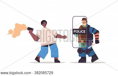 Policeman In Full Tactical Gear Riot Police Officer Attacking African American Protester With Smoke