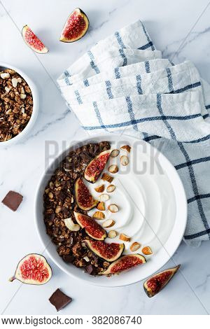 Greek Yogurt Chocolate Almond Nuts Oatmeal Granola With Figs In A Bowl