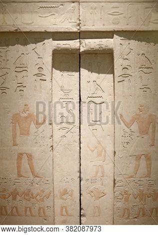 Egyptian hieroglyphs on the wall