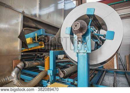 Galvanized Steel Roll In Metal Sheet Forming Machine In Metalwork Factory, Close Up.