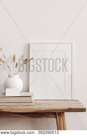 Portrait White Picture Frame Mockup On Vintage Bench, Table. Modern Ceramic Vase With Dry Lagurus Ov