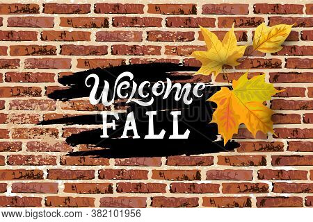 Welcome Fall Handwriting Lettering With Falling Leaves On Brick Wall Background. Place For Text. Gre