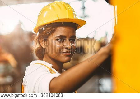 Happy African American Woman Worker With Safety Suit Helmet Enjoy Smiling Working As Labor In Heavy
